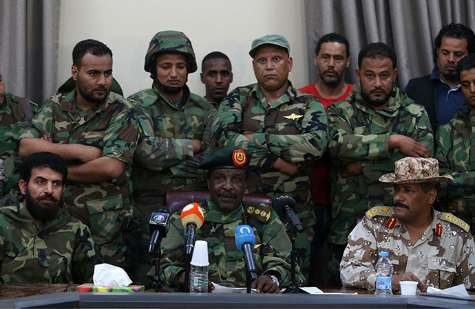 Libyan Army Special Forces Commander Wanis Bukhamada (front C) delivers a statement in Benghazi May 19, 2014. Bukhamada has allied with renegade general Khalifa Haftar in his campaign against militant Islamists, highlighting the failure of central government in Tripoli to assert its authority. (Reuters / Esam Al-Fetori)