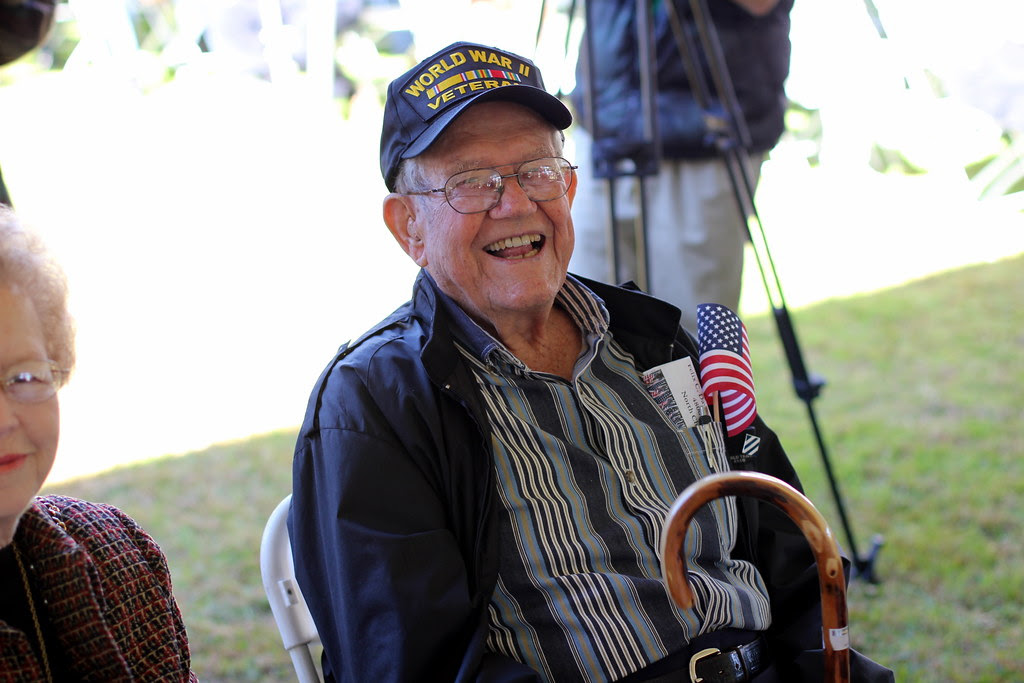 A WWII veterans gives a smile