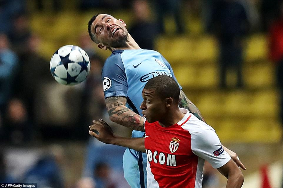 Aleksandar Kolarov leaps to win a header as City struggled to impose themselves on the second leg tie in Monaco