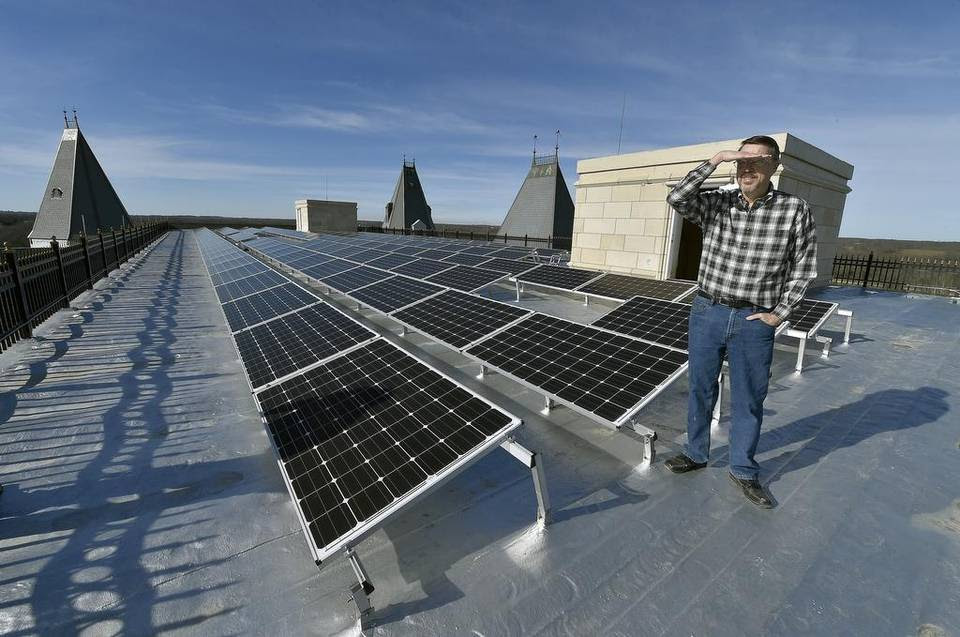 The roof of the main house contains a solar panel array that Steven T. Huff stands next to on the 72,000 square foot Chateau Pensmore under construction on Wednesday, December 10, 2015 near Highlandville, Mo.