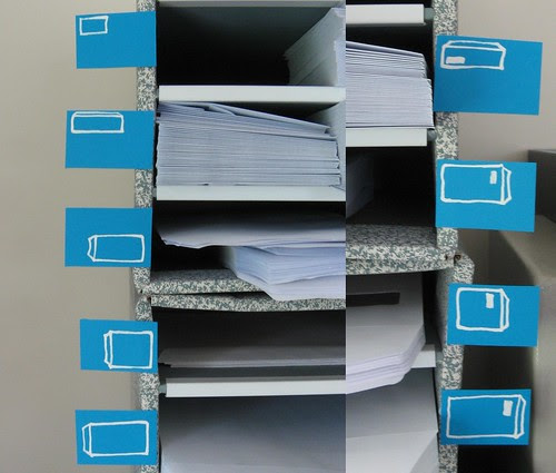 Labelled drawers of envelopes