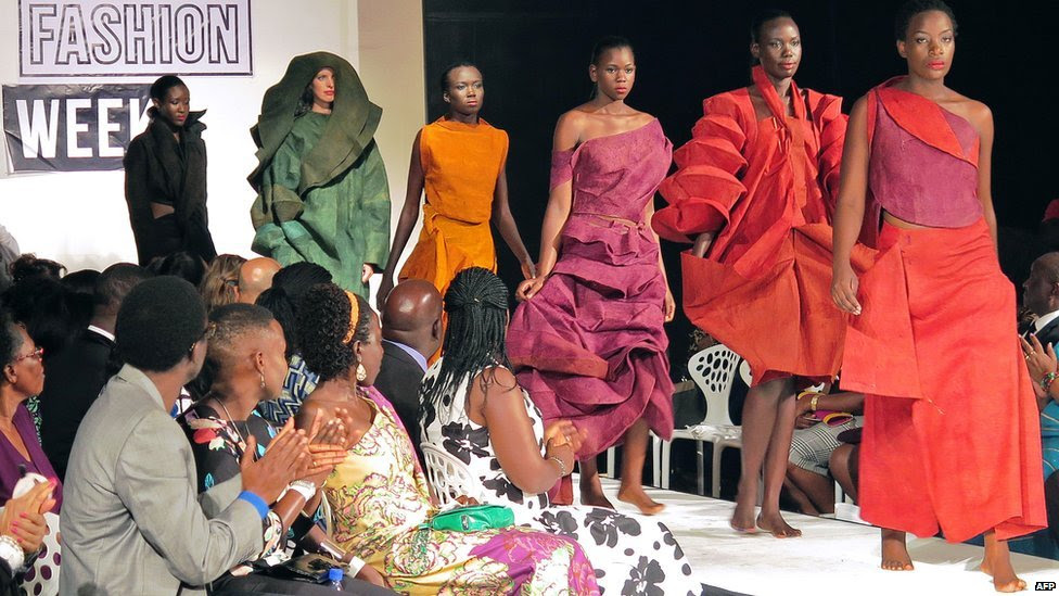 Models present creations made of bark cloth material by fashion designer Jose Hendo during the first fashion week show held in Kampala on 15 November 2014