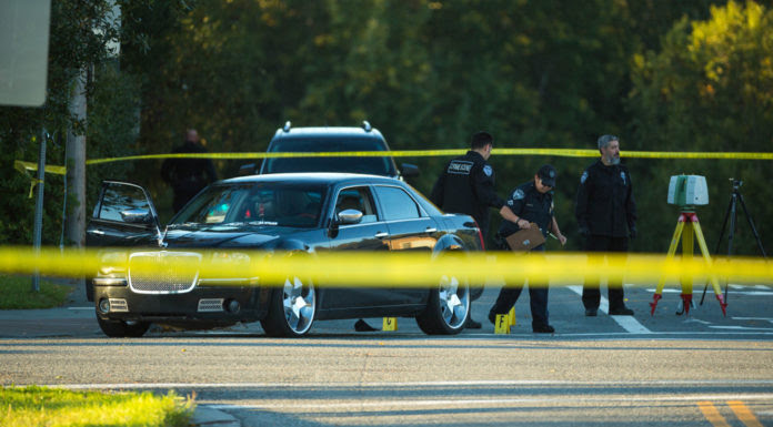 Anchorage police crime scene investigators process the scene of a fatal shooting at 15th Ave and E St early Tuesday morning, Sept. 13, 2016. One person has been taken into custody in connection with the shooting. (Loren Holmes / Alaska Dispatch News)