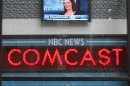 The news ticker outside the Today Show announces GE's sale of NBC to Comcast, in New York