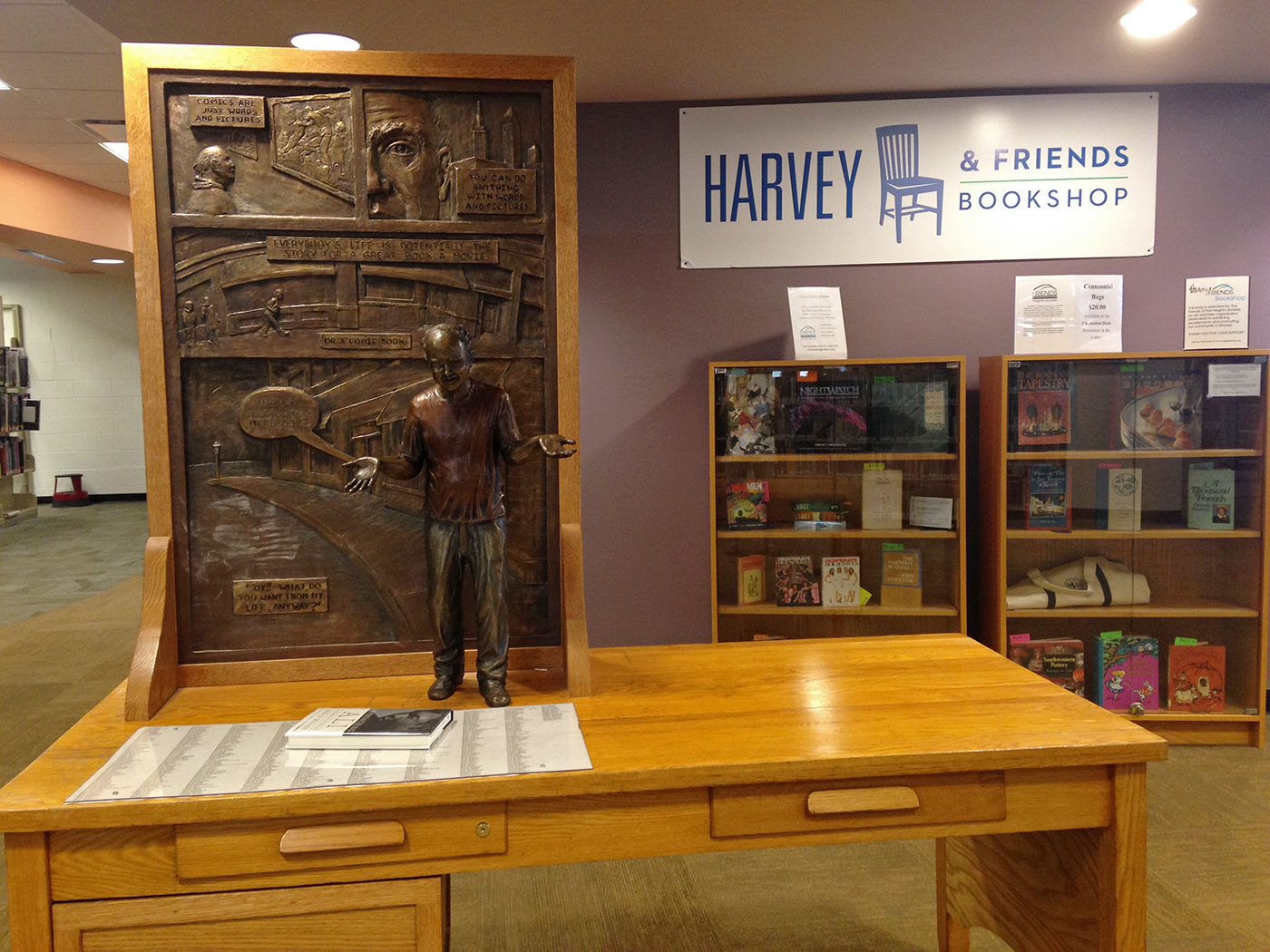 Harvey Pekar's memorial statue, designed by Justin Coulter, and desk at the Cleveland Heights-University Heights Library (photo by the author for Hyperallergic) (click to enlarge)