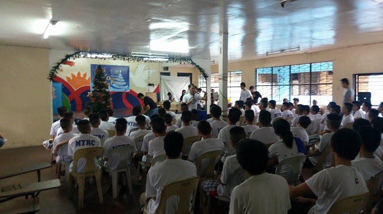 Al Ian Barcelona speaking to beneficiaries of the outreach program