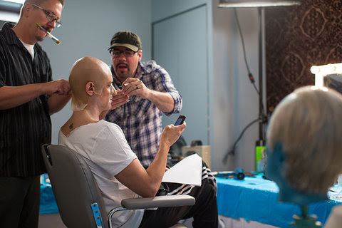 Stephen Prouty, left, applying makeup to Johnny Knoxville.