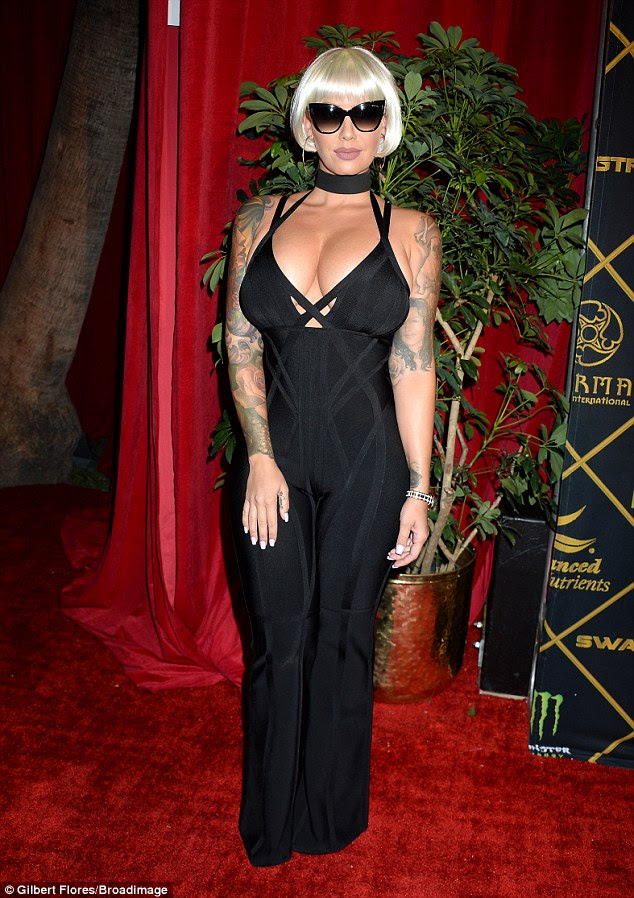 Busty babe: Amber Rose, 32,  put on quite the eye-popping display while attending the Maxim Hot 100 party in Hollywood on Saturday
