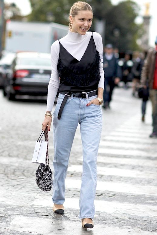 Le Fashion Blog 90s Inspired Street Style Pernille Teisbaek Drop Earrings Black Fringe Cami Top Layered Over A White Long Sleeve Turtleneck Top Belt Bag Light Wash Jeans Cap Toe Shoes Via Style Caster