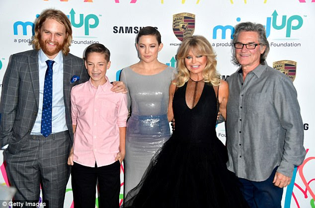 Fun with family: Wyatt Russell, Ryder, Kate, Goldie Hawn, and Kurt Russell (pictured from left to right) posed for a cute family snap together