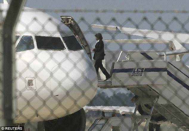 An official boards a hijacked Egyptair A320 Airbus at Larnaca Airport in , Cyprus, to negotiate with the hijacker, who has since been identified as Ibrahim Samaha