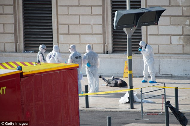 Out of custody: The attacker, pictured lying dead  after he was gunned down outside Saint Charles station, Marseille, was an illegal immigrant who had been arrested last week