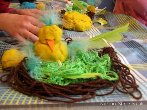 spring sensory bin with play dough and craft supplies