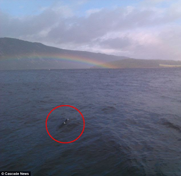 Could this be Nessie? Jon Rowe, a fish farm worker from Lewiston, photographed a large, dark shape in the water while photographing a rainbow