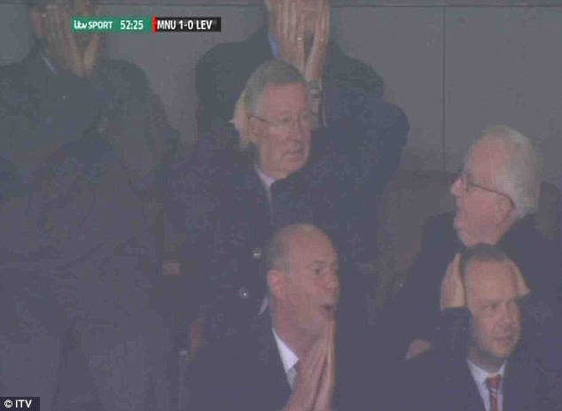 Agony: David Moyes can't believe Rooney has missed, and neither can Sir Alex Ferguson (below) in the stands