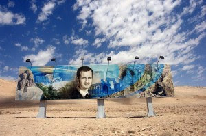 Roadside_mural_of_Bashar_al_Assad_along_the_Damascus-Aleppo_highway-300x199