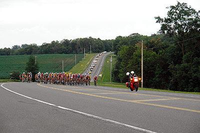 The men's peloton approaches the gravel