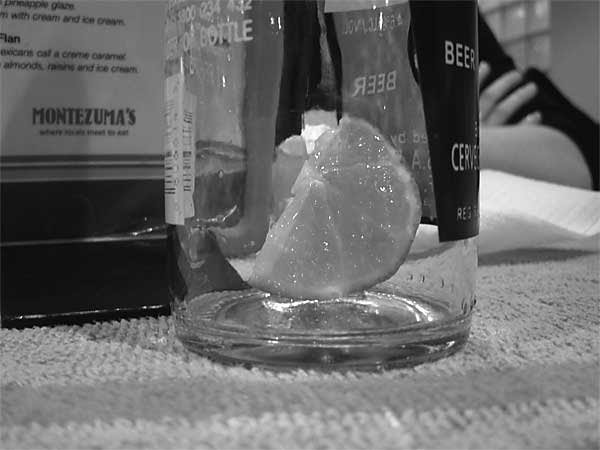 the lime slice at the bottle of a bottle of Corona
