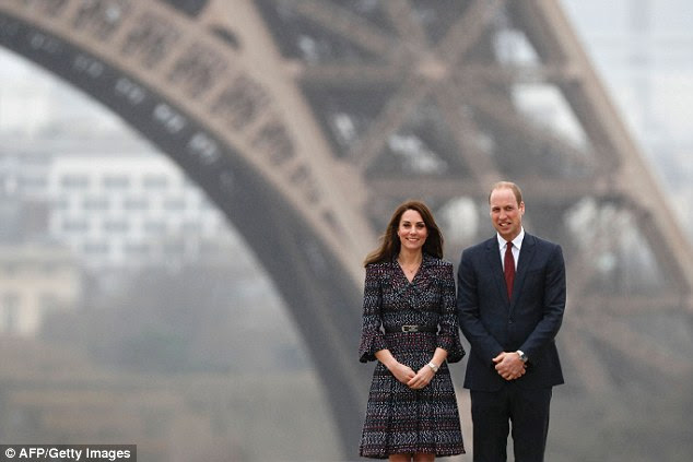 Prince William and wife Kate, Duchess of Cambridge, pose in front of the Eiffel Tower during a visit to Paris today