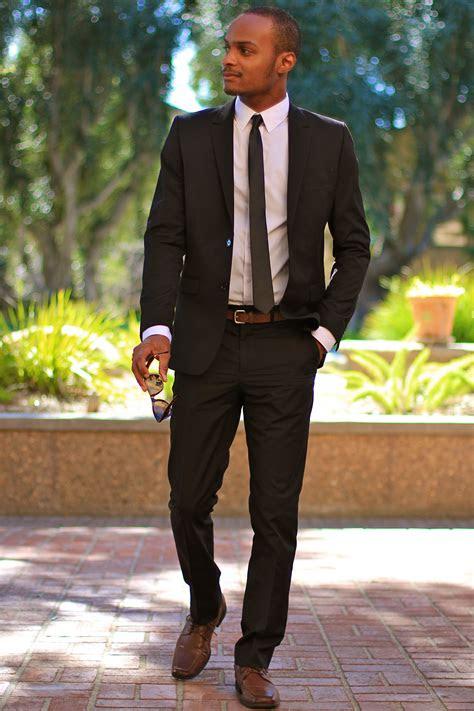 black suit brown shoes black skinny tie menswear