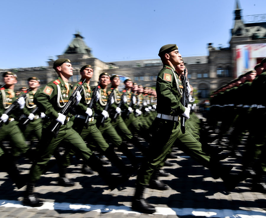 Russian servicemen march at Red Square during the Victory Day military parade