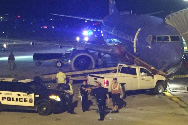 A truck crashed through a fence and into a Southwest Airlines plane at Eppley Airfield in Omaha, Nebraska