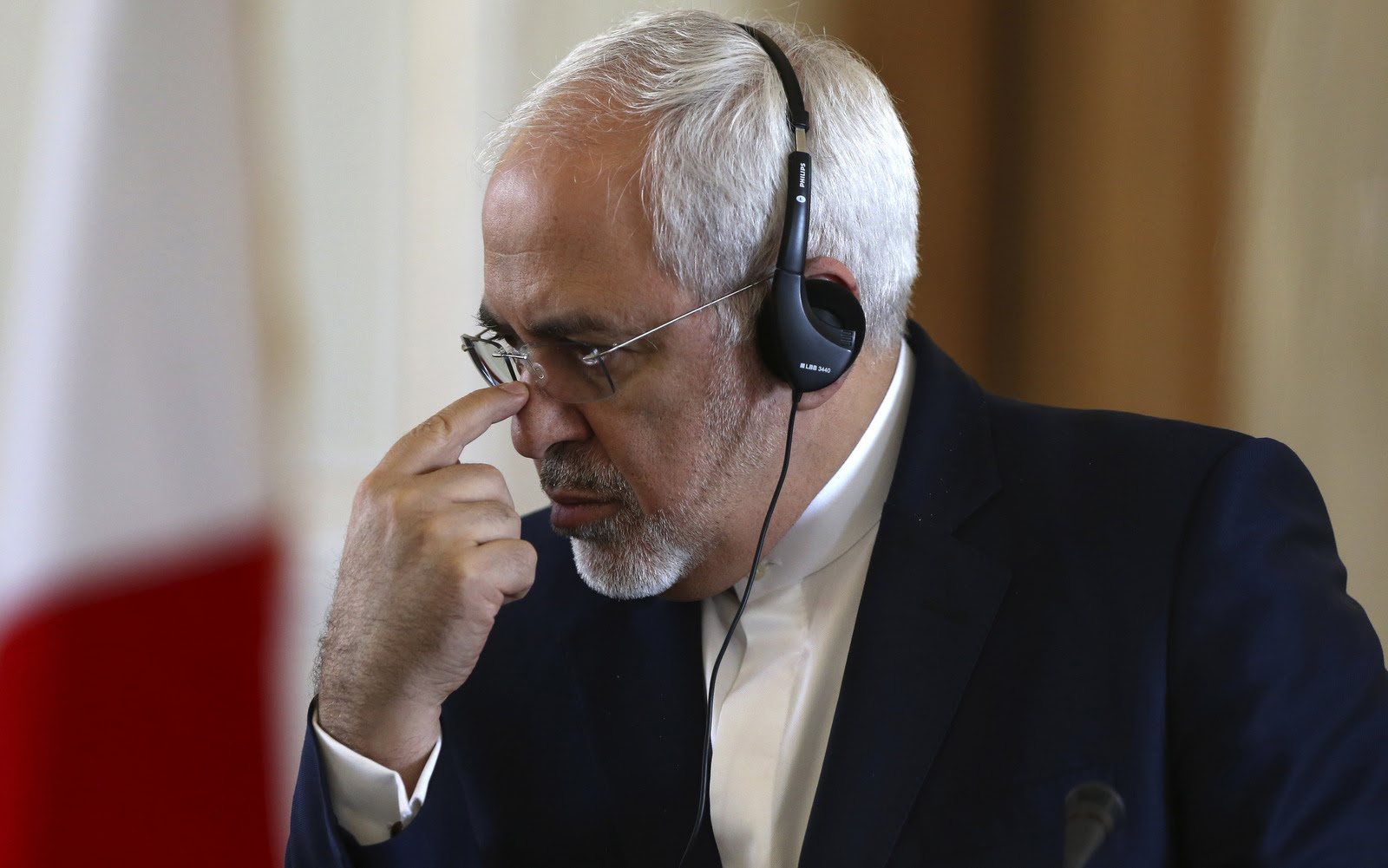 Iranian Foreign Minister Mohammad Javad Zarif pauses while listening to a translation of his French counterpart Jean-Marc Ayrault during their joint press conference in Tehran, Iran, Jan. 31, 2017.(AP/Vahid Salemi)