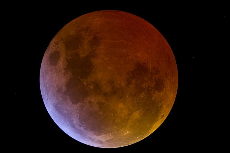 An eclipsed Moon can take on a reddish glow during totality