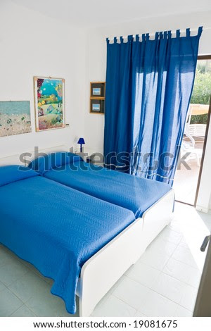 Interior Of Beautiful Bedroom With Large Window. Stock