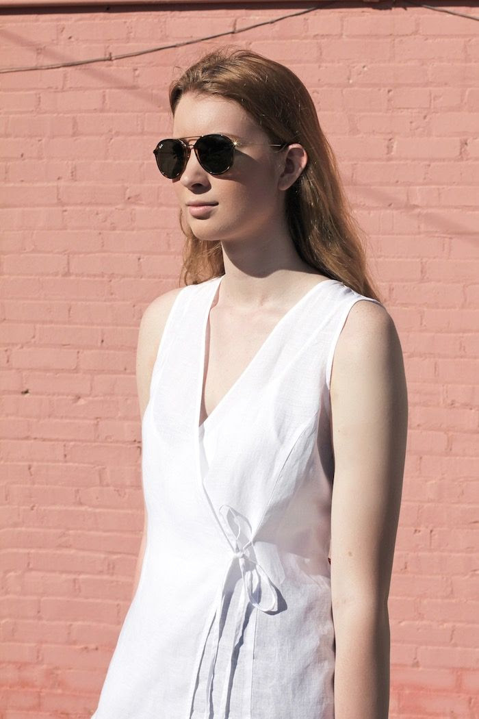How To Wear White Linen Wrap Top Tort Aviator Sunglasses Summer Outfit Minimalist Inspiration Eileen Fisher Strawberry Blonde Wavy Hair Le Fashion Blog