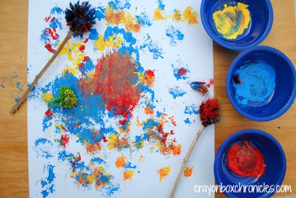 http://crayonboxchronicles.com/2014/01/29/yarn-pom-pom-drumstick-painting/
