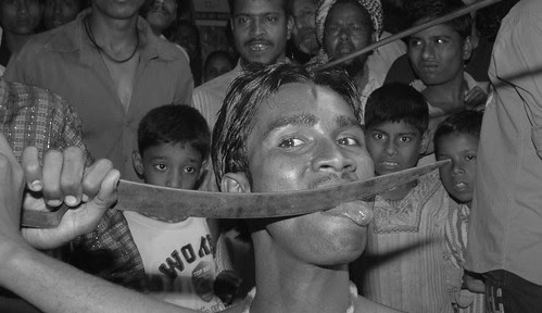 Inserting a rod in the head and cutting the tongue -Mohammad Rafaee by firoze shakir photographerno1