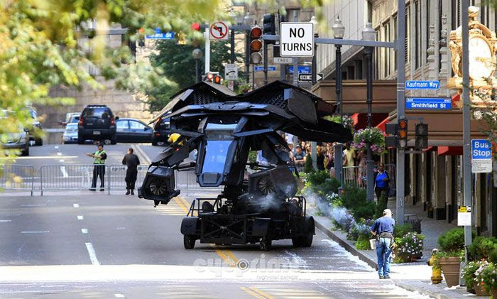 The Batwing movie prop is driven around THE DARK KNIGHT RISES' film set on top of a stunt car.