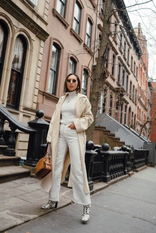 Le Fashion Blog Aimee Song Neutrals Round Sunglasses Gold Jewels Cream Colored Wool Coat Off White Turtleneck Wide Leg Jeans Snakeskin Booties Via Song of Style