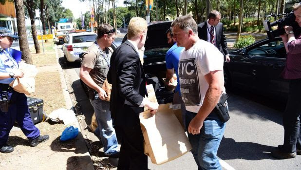 Police take evidence from an upmarket apartment at Sydney's Olympic Park on Tuesday.