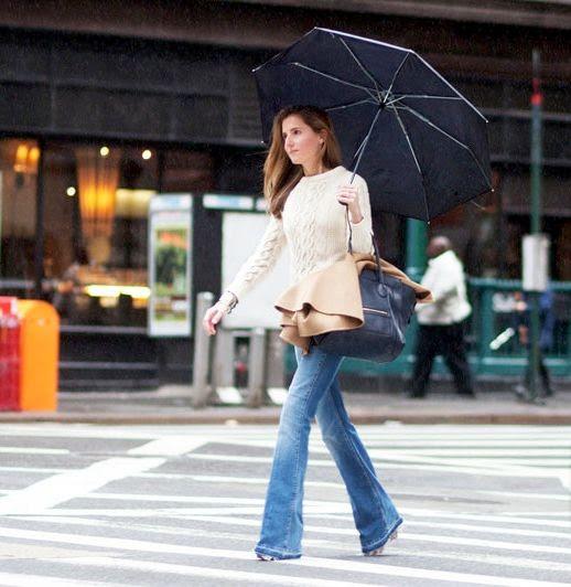 Le Fashion Blog Rainy Day Street Style Umbrella Marina Larroude Cable Knit Sweater Flared Jeans Via Garance Dore photo Le-Fashion-Blog-Rainy-Day-Street-Style-Umbrella-Marina-Larroude-Cable-Knit-Sweater-Flared-Jeans-Via-Garance-Dore.jpg