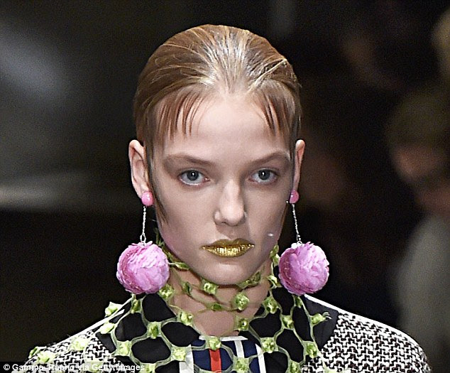 Prada: Ornate flower drop earrings were seen at the spring 2016 Prada show in Milan