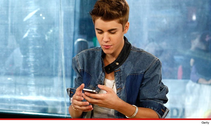 Justin Bieber worried cops will find naked pics on his