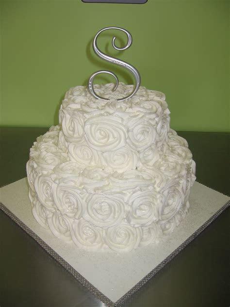 2 tier wedding cake with rose design buttercream