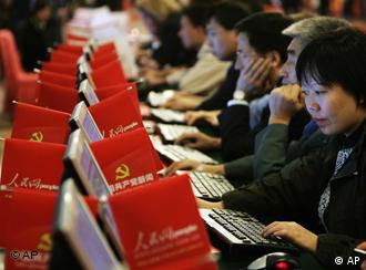 Delegates surf the People's Website on Chinese Communist Party News during the 17th Communist Party Congress held at the Great Hall of the People in Beijing, Monday, Oct. 15, 2007. Chinese leader Hu Jintao pledged Monday to make the communist government more open and responsive while moderating the juggernaut economy to produce more balanced growth.(AP Photo/Andy Wong)