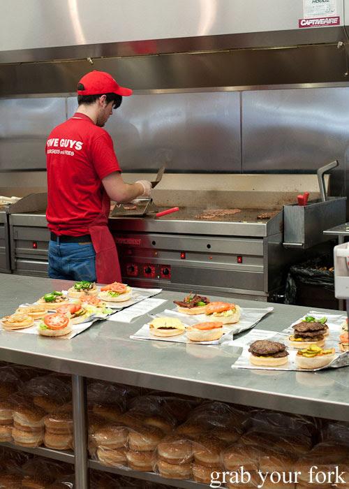 burger hamburger cheeseburger  assembly kitchen Five Guys burgers fast food Kansas City Ward Parkway