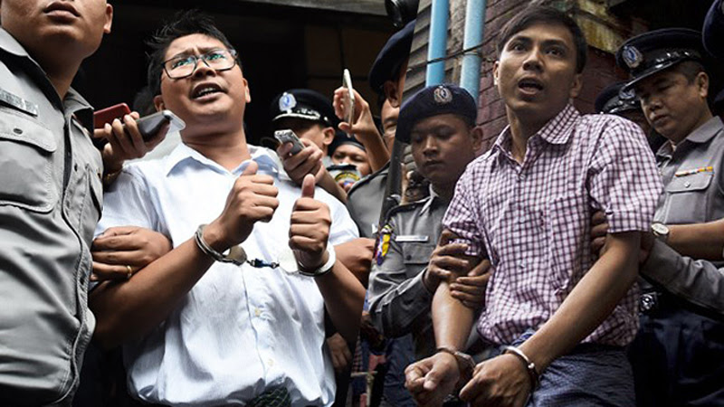 The two Reuters journalists Wa Lone photo by Ye Aung Thu leaving Court.