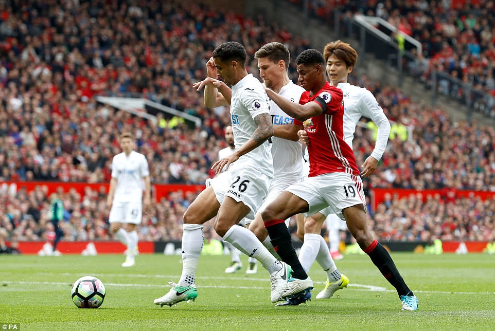 Marcus Rashford gets crowded out by a host of Swansea defenders in a solid defensive display in the first half for the visitors