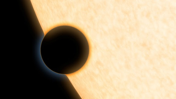 Artist's concdption of a Neptune-sized planet with a clear atmosphere, passing across the face of its star. Credit: NASA/JPL-Caltech