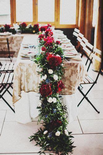 Head Table. Lavishly floral garland with burgundy peonies