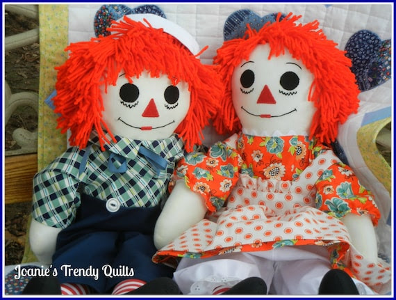 """Raggedy Ann and Andy set. 25"""" in size. Clothing made with premium cotton fabric. Embroidered heart with """"I Love You."""""""