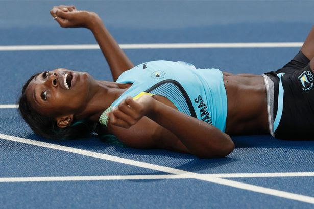 Shaunae Miller reacts after winning