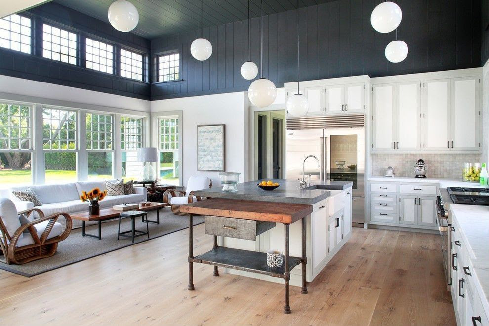 Country Kitchen with L-shaped, Flat panel cabinets, Pental aspen honed marble, Hardwood floors, Simple marble counters