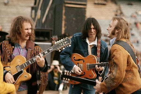 December 1969, San Diego-- David Crosby, Neil Young, and Stephen Stills.  Crosby, Stills, and Nash were formed in the late sixties from members of The Hollies, The Byrds, and Buffalo Springfield.  CSN collaborated with Neil Young occasionally, and racked up many hits in the 60s & 70s. Young went on to create more critically acclaimed music with Crazy Horse and his many solo albums. --- Image by © Henry Diltz