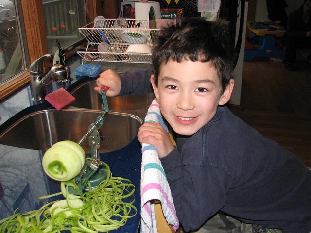 Adam helps peel apples